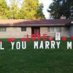 Love will you marry me proposal display with hearts